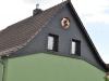 Fassadengestaltung mit Faserzement und Eule in Seelow